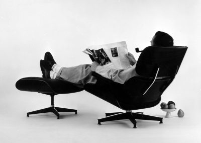 14.-The-World-of-Charles-and-Ray-Eames.-Charles-Eames-in-the-plywood-Lounge-and-Ottoman,-1956.-©-Eames-Office-LLC