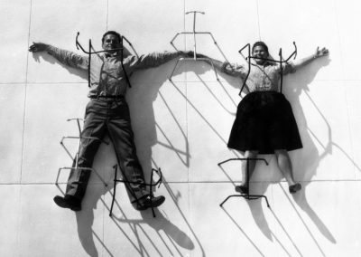 3.-The-World-of-Charles-and-Ray-Eames.-Charles-and-Ray-Eames-posing-with-chair-bases-©-Eames-Office-LLC
